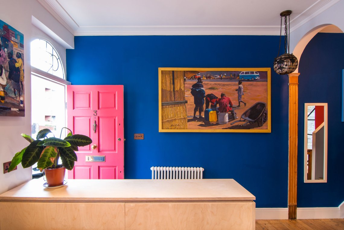 Bright-colours-blue-wall-pink-door-paintings-mirror-timber-floor-renovation-London