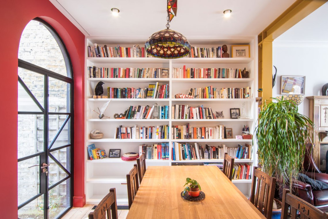 Dinning-area-bookshelf-door-bright-colours-floorboards-London