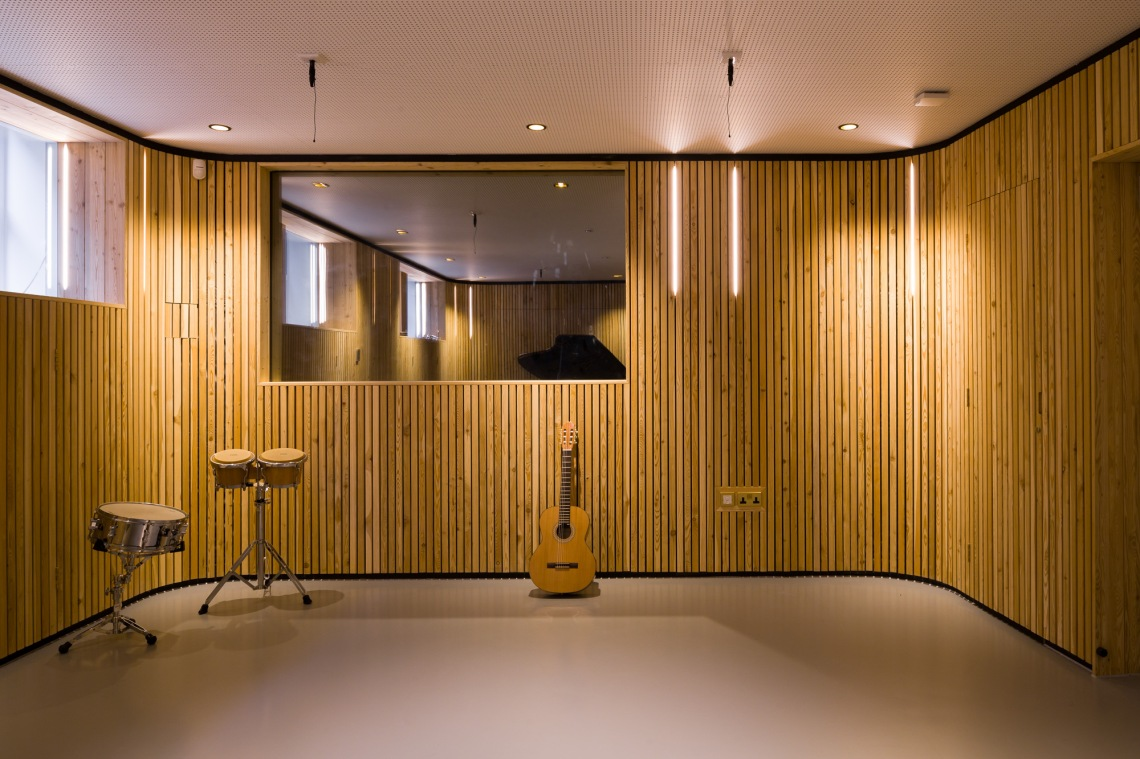 Music-Therapy-Room-Architecture-Timber-Battens-LED-Guitar-Drum-2