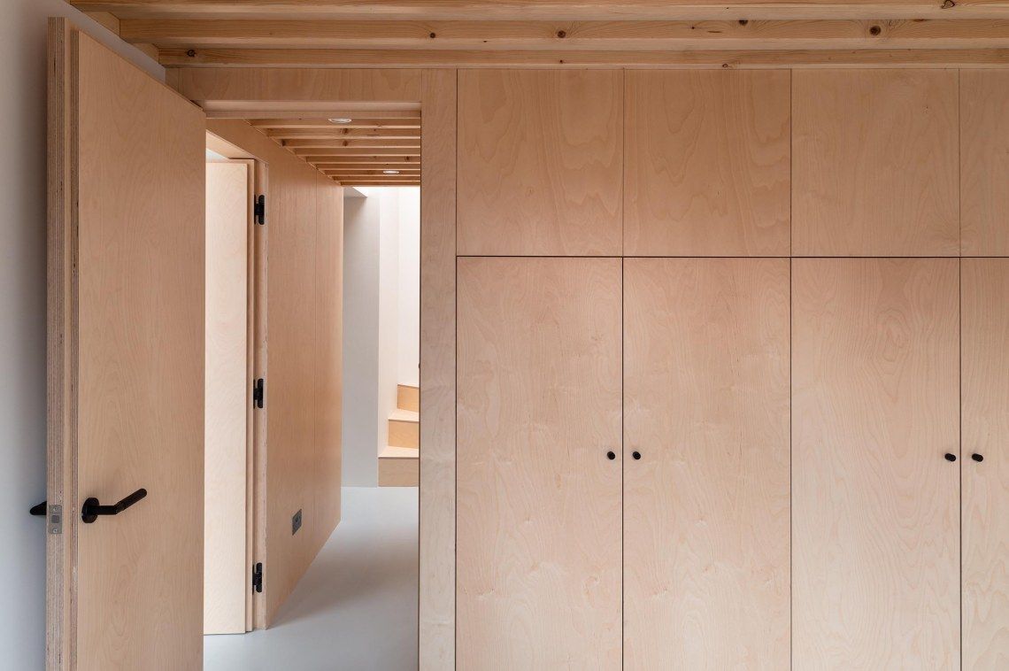 BVDS Architects Two and a half story house ply storage wardrobe exposed joists