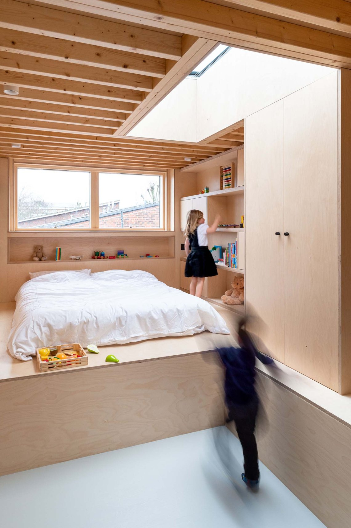 BVDS Architects Two and a half story house ply timber exposed joist rooflight kid running play loft extension