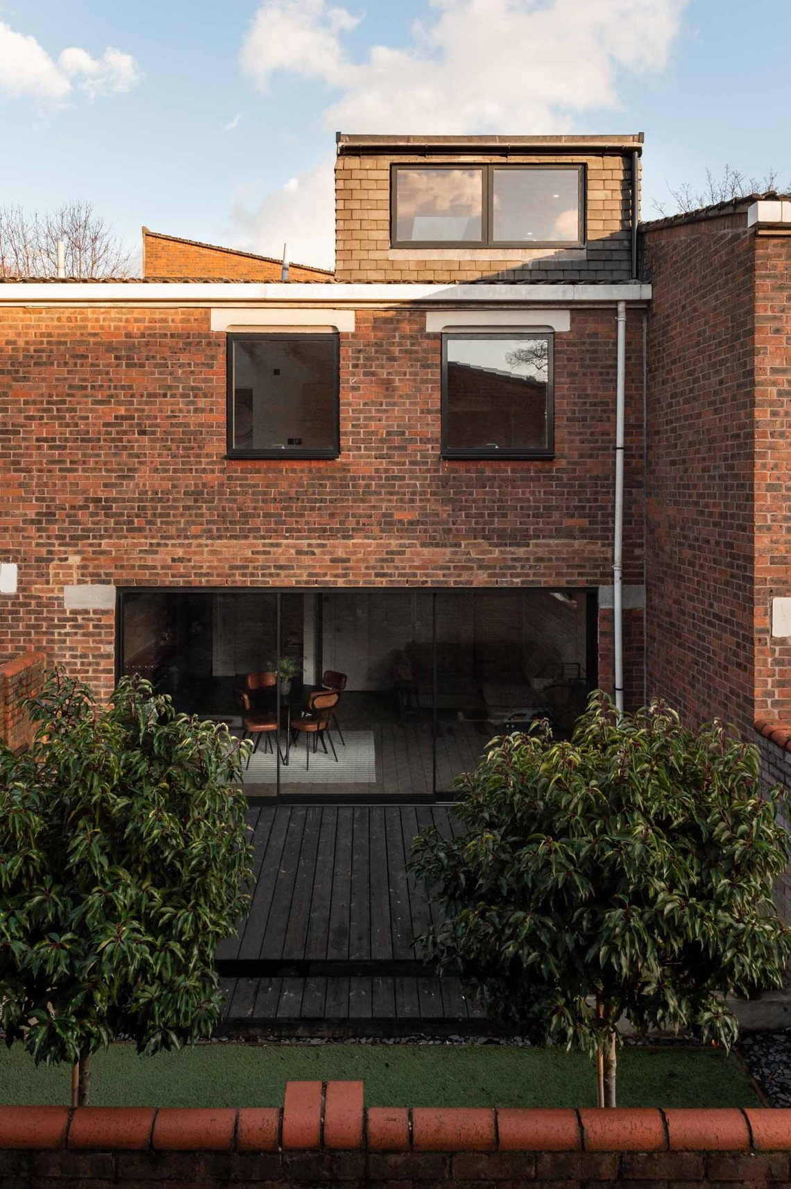 BVDS Architects Two and a half story house rear garden loft extension glazing sliding doors exterior