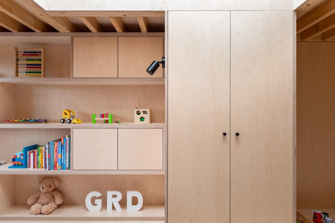 BVDS Architects Two and a half story house timber ply joinery exposed joists rooflight wardrobe kids room toys