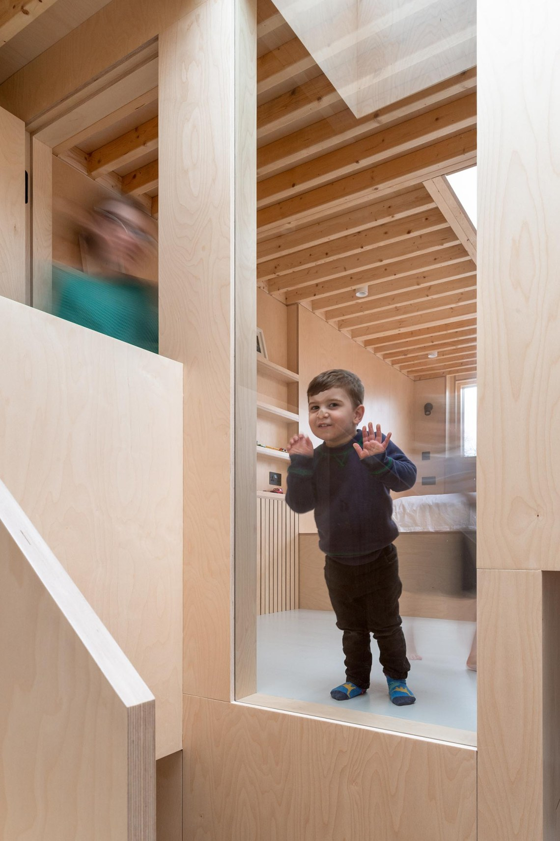 BVDS Architects Two and a half story house window ply exposed joists child room loft extension